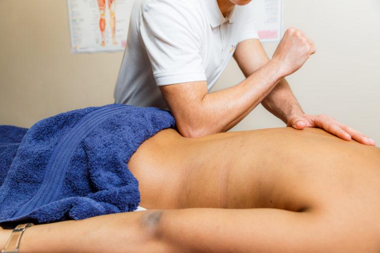 Spoets massage on female back