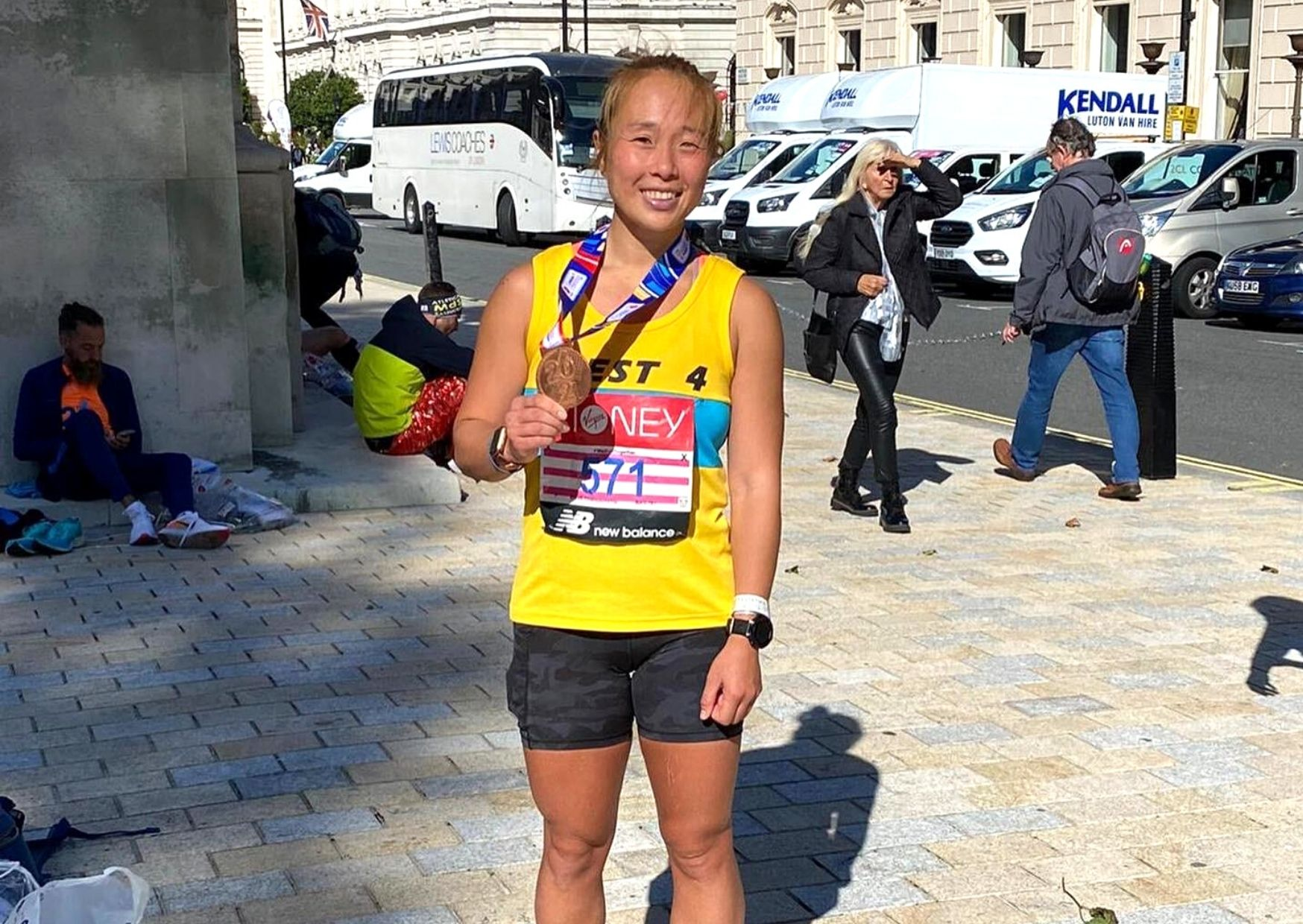 pic of marathon runner after exercise improving her physical wellbeing